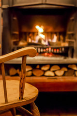 Home comfort. Rocking chair near the fireplace. Photo of interior