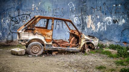 Istanbul, Turkey - March 03, 2013 - Rusty scrap car in Fener Balat district
