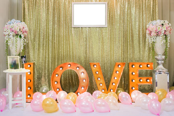 Wedding decoration background with word love light stand.