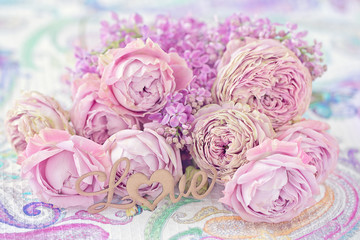 Lovely bunch of flowers .Close-up floral composition with a pink roses on a table. Beautiful bouquet for a birthday or Valentine's Day.Congratulation with a flowers .