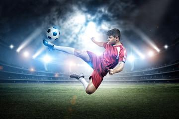 Football player's kicking in the stadium