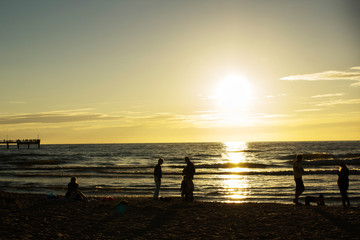 silhouettes of people on the beach