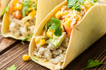 Homemade delicious tacos with chicken and vegetables