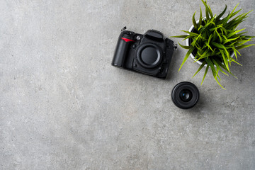 Modern camera on gray stone table