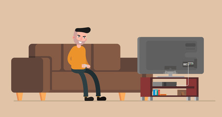 Man sitting on the couch and playing console