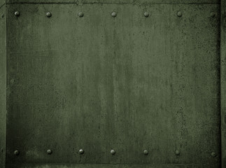 Wall Mural - old military metal green armor background with rivets