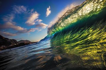 Vibrant green ocean wave rip curl rising