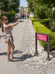 Young, pretty woman on summer holiday, Alhambra in Granada, Spai