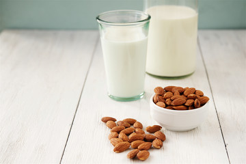 Almonds and almond milk in the background