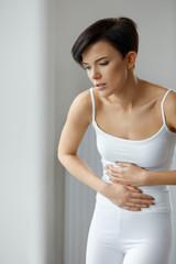 Woman Health. Beautiful Female Feeling Pain In Stomach