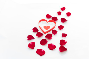 Rose petals and heart paper isolated on white