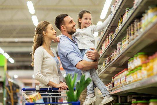 family with food in shopping cart at grocery store