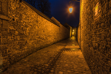 Old french mediewal cobbled street in Carentan,France