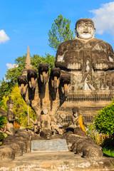 Vishnu reclining posture and Katyayana in background at Sala Keo