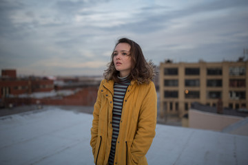 Brunette woman in winter on New York City rooftop