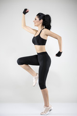 beautiful brunette woman doing various exercise fitness