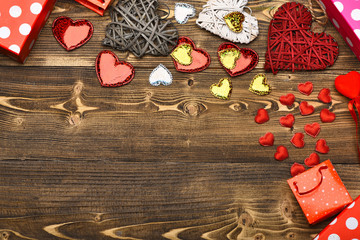 present package and heart on wood as valentines decoration