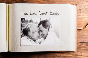 Photo album with black-and-white picture of senior couple.