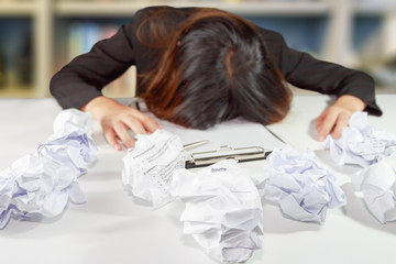 Stressed business woman make a mistake with chewed resume paper.
