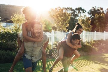 Young people having fun in backyard garden