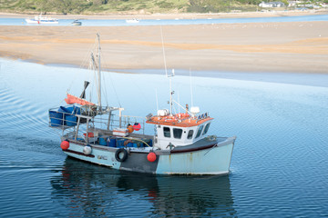 Fishing boat arrives in the port of Padstow at the Camel estuary in north Cornwall.