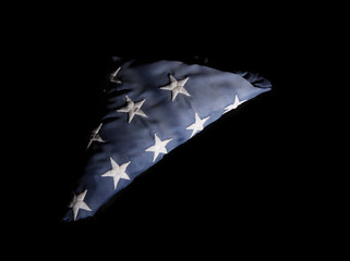 Closeup of a old american flag on a black background