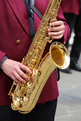 player plays the saxophone in the brass band