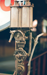 The old grunge gas pump fuel nozzle in vertical picture vintage style.