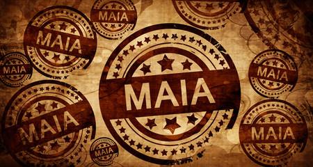 Maia, vintage stamp on paper background