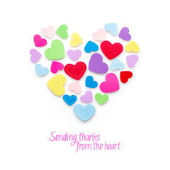 Sending thanks from the heart / Creative valentines concept photo of  hearts made of paper on white background.