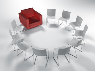 Circle of white chairs with a single red one