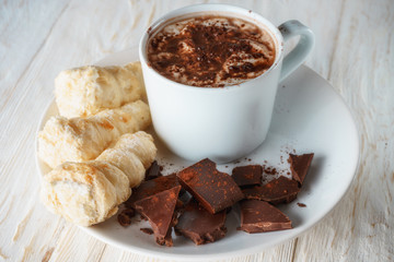 Cup of cocoa and dessert