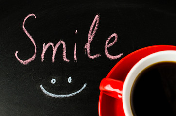 Cup of Coffee on a Dark Background. Inscription Smile.