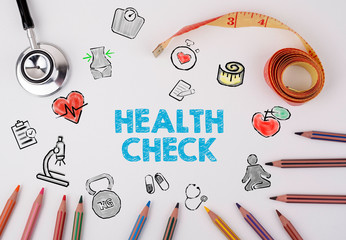 Health Check concept. On the table stethoscope and colored pencils
