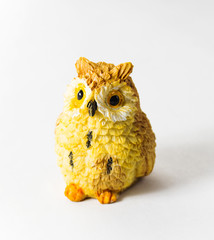 Toy owl on a white background
