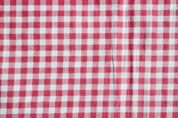 Red picnic tablecloth background, red and white checkered fabric.
