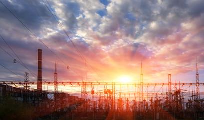 electricity distribution station at sunset .