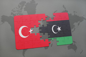 puzzle with the national flag of turkey and libya on a world map