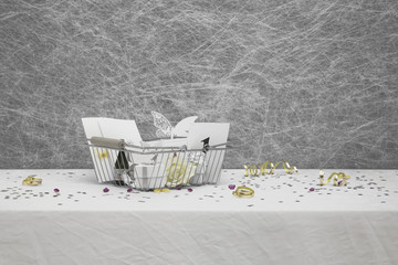 Wedding Favors in a shopping basket on a White tablecloth