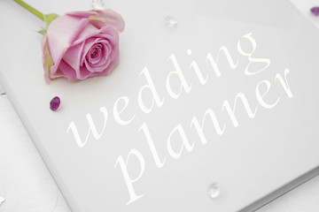 Wedding planner book with a pink rose on top