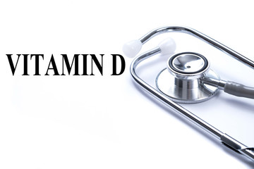 Page with VITAMIN D on the table with stethoscope, medical conce