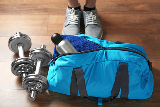 Male legs and sport bag on the floor