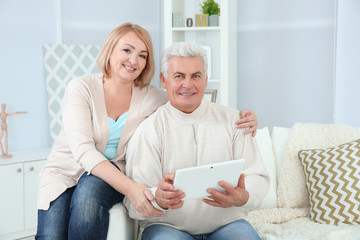 Grandparents using tablet at home