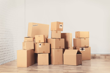 House move concept. Carton boxes on floor in room