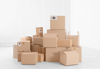 House move concept. Carton boxes on white wall background