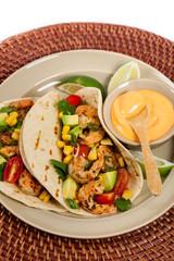 Shrimp Tacos with Corn and Avocado Salsa. Selective focus.