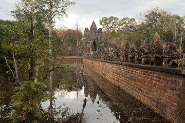 Bridge with statues and ancient gate near Angkor Wat