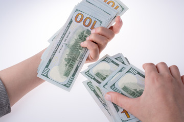 Human hand holding American dollar banknotes on white background