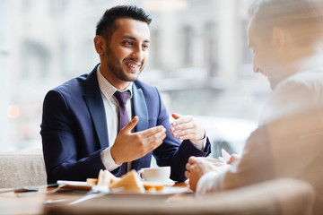 Arabic Businessman at Meeting in Cafe