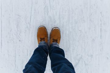 Human walking on winter road